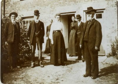 Group outside cottage early 1900s